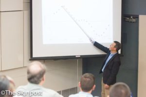 """Dr. Adam Johnston shows a chart on how ballet dancers defy gravity during his """"Physics of the Mudane"""" seminar.(The Signpost/ Christina Huerta)"""