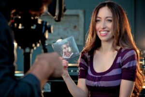 Meytal Cohen holding a copy of her band's first album. Credit: Meytal Cohen/Outerloop