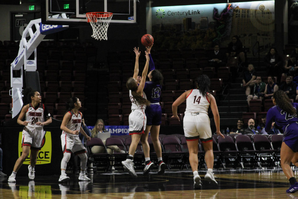 Kayla Watkins going for the basket. (BriElle Harker / The Signpost)