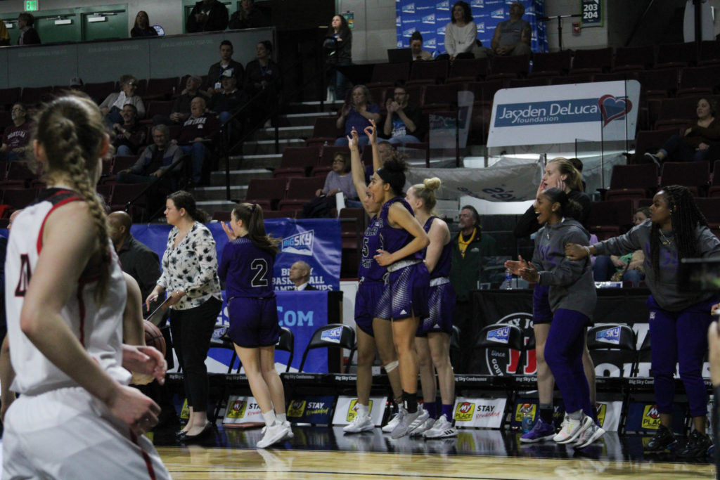 Weber State players cheering on the game. (BriElle Harker / The Signpost)