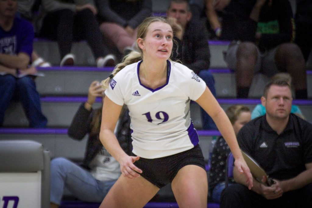 Weber State's #19 Ashlyn Power watches for the volleyball in defense of the court during the game against Sac State. (Kalie Pead/ The Signpost)