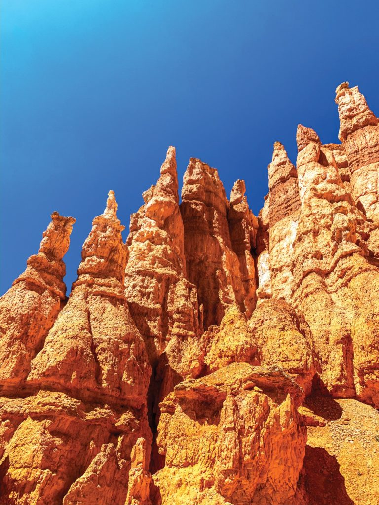 Hoodoos tower over you as you walk beneath them. (Israel Campa/The Signpost)