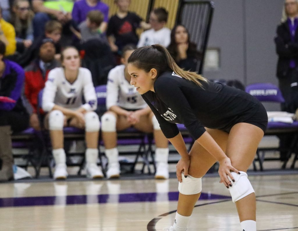 Wildcat Helena Khouri waits for a serve from the Thunderbirds. (Robert Lewis / The Signpost)