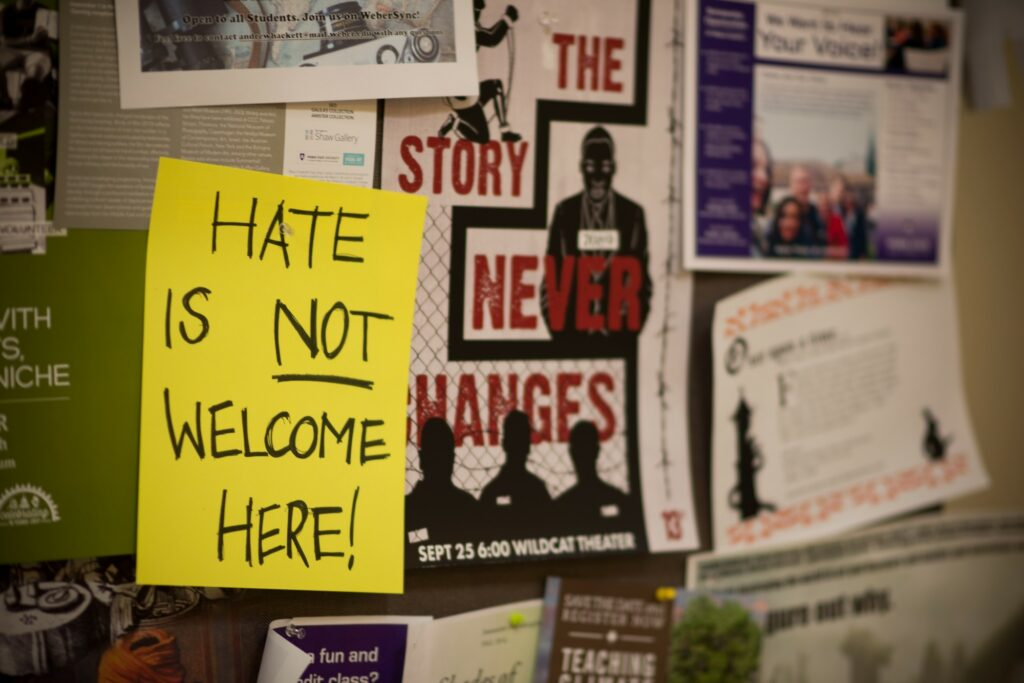 One of several signs which hang in Elizabeth Hall, each a response to the white nationalist flyers recently posted and then removed. (Joshua Wineholt / The Signpost)