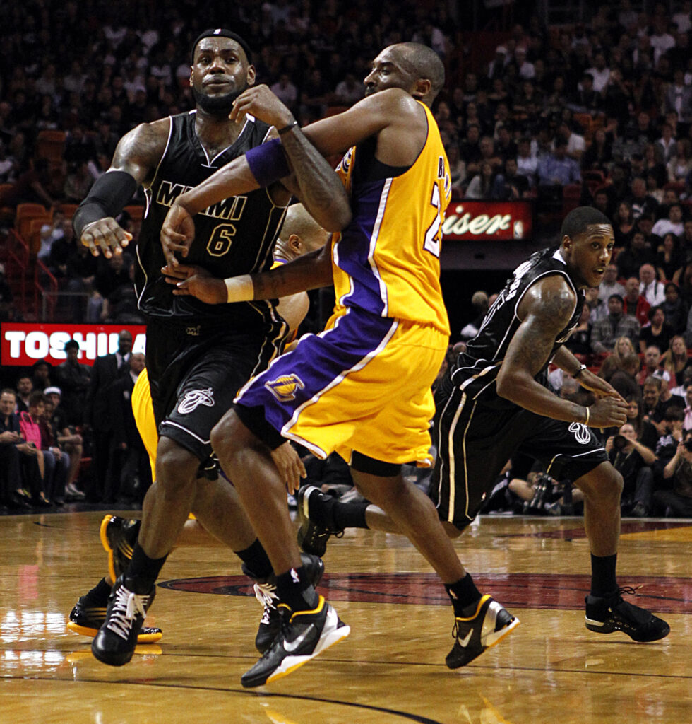 Miami Heat's LeBron James gets tangled with Los Angles Lakers's Kobe Bryant in the second quarter at the American Airlines Arena in Miami, Florida, January 19, 2012. (Charles Trainor Jr./Miami Herald/TNS)