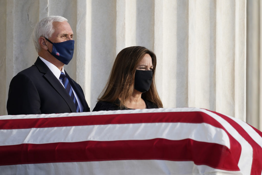 Vice President Mike Pence and second lady Karen Pence pay respects as Justice Ruth Bader Ginsburg lies in repose under the Portico at the top of the front steps of the Supreme Court building on September 23, in Washington, D.C. (Alex Brandon/Pool/Sipa USA/tns)