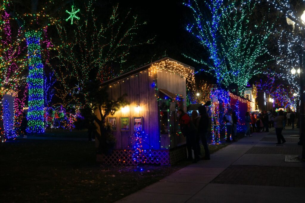 The Municipal Gardens are full of Christmas lights and small houses. (Israel Campa / The Signpost)