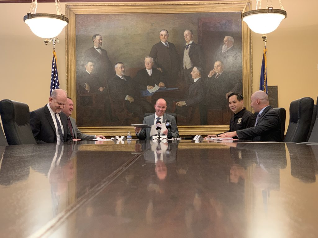 Attorney General Sean Reyes, second from right, sits with other members of the Utah State Board of Canvassers (left to right, Treasurer David Damschen, Auditor John Dougall, Lt. Governor Spencer Cox and Elections Director Justin Lee) to certify the 2018 election. Reyes won re-election to his post today. (Photo by Ben Winslow, FOX 13 News via Tribune News Service)