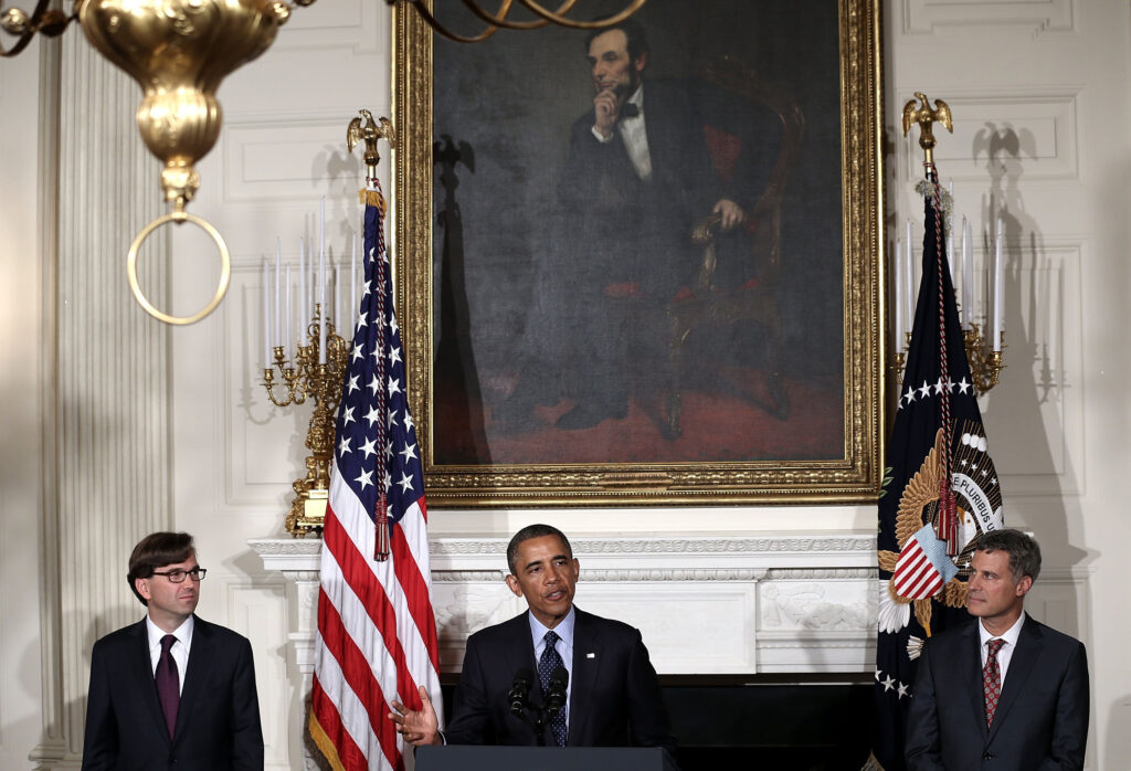 U.S. President Barack Obama speaks as chairman of the Council of Economic Advisers Alan Krueger, right, and economist Jason Furman listen during a personnel announcement in the State Dining Room of the White House in June 2013. In 2012, Krueger introduced the Great Gatsby curve, a graph that showed that the more inequality that exists between the rich and the poor, the harder it is for low-income people to climb up the socioeconomic ladder. (Alex Wong/Abaca Press/TNS)