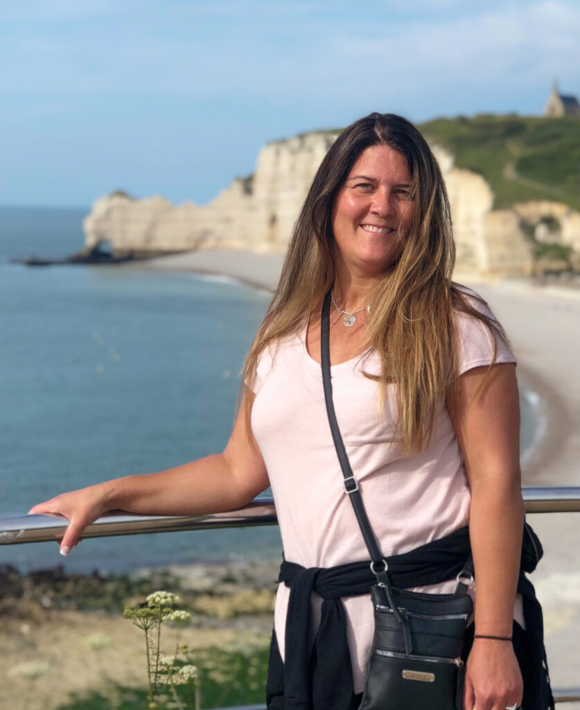 Shauni Brown in front of the cliffs at Etretat. (Paige McKinnon / The Signpost)
