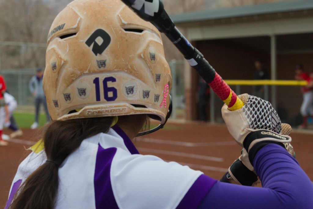 No. 16 Chloe Camarero gears up to take a swing at home plate. (Kelly Watkins / The Signpost)