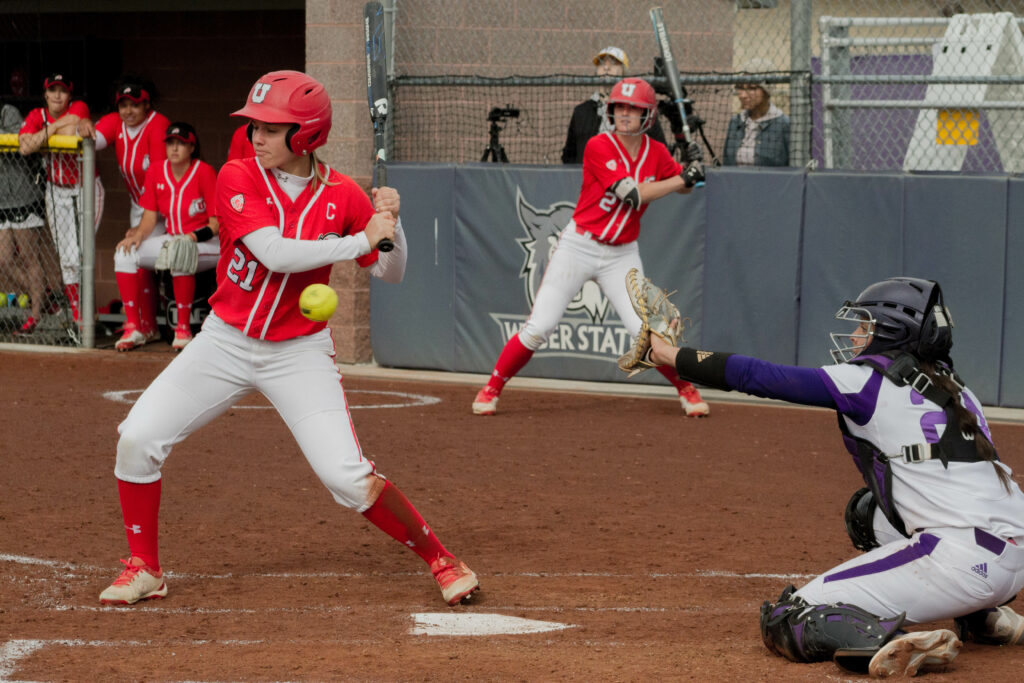 Lauren Hoe keeps her eye on the ball as Utah steps up to the plate to bat. (Kelly Watkins / The Signpost)