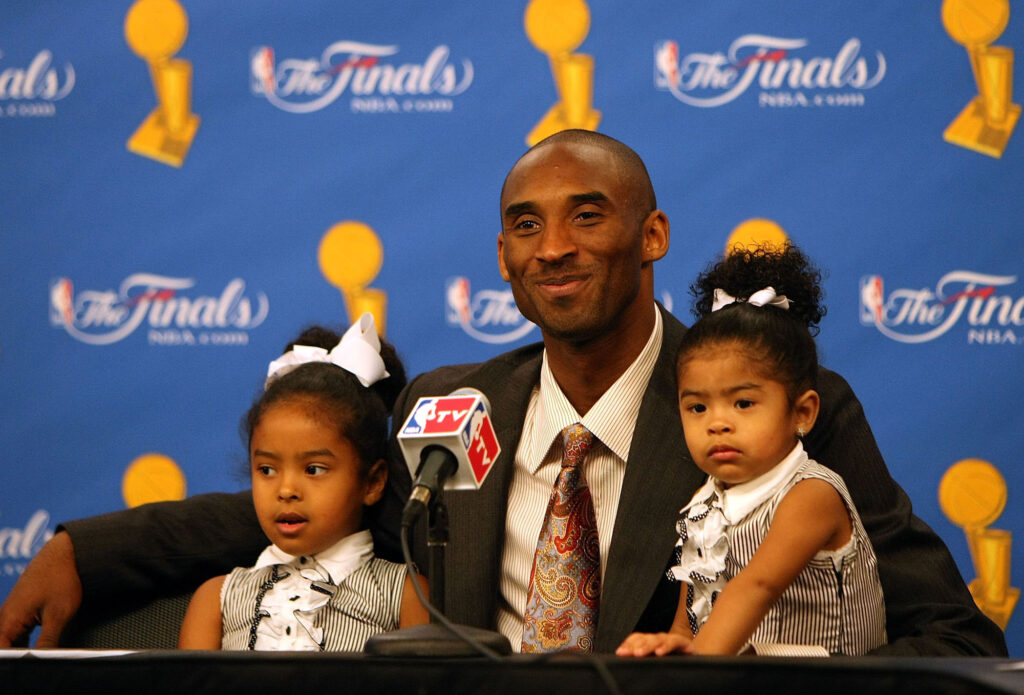 The Los Angeles Lakers' Kobe Bryant sits with daughters Natalia, left, and Gianna, right, during a news conference after the Lakers' win against the Boston Celtics in Game 5 of the 2008 NBA Finals on June 15, 2008, at Staples Center in Los Angeles. (Jed Jacobsohn/Getty Images/TNS)