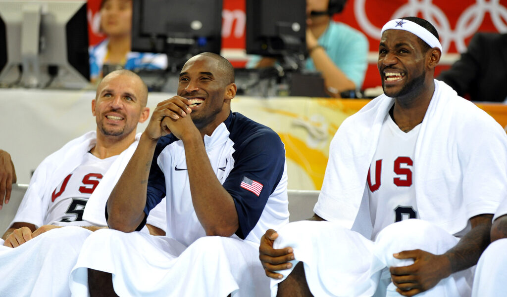 Jason Kidd, left, Kobe Bryant, center, and LeBron James of the United States share a laugh on the bench during a game Australia on Wednesday, August 20, 2008, in the Games of the XXIX Olympiad in Beijing, China. (Joe Rimkus Jr./Miami Herald/TNS)
