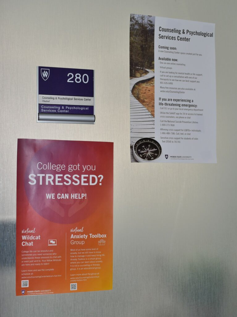 Informative flyer hang on the entrance to the Counseling and Psychological Services Center at Weber State University. (Paige McKinnon/The Signpost)