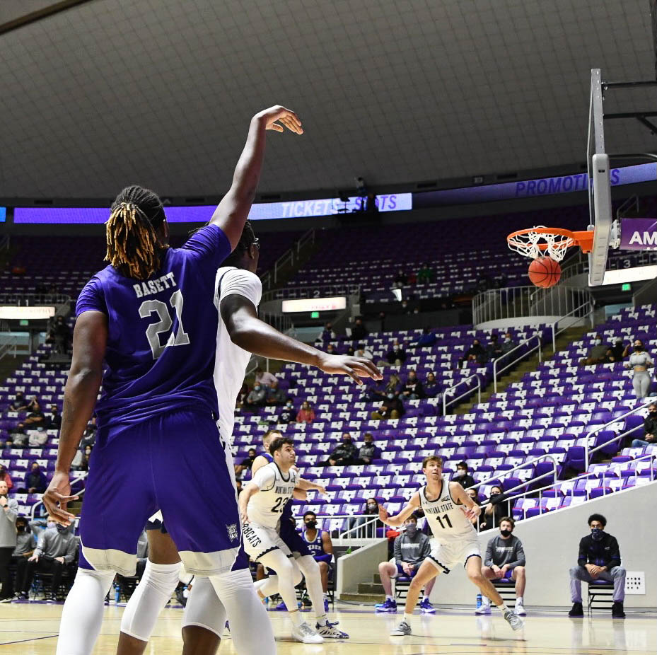 Tossing in a 3-pointer, Dontay Bassett adds to the win for the Wildcats in Saturday's game.  Nikki Dorber / The Signpost