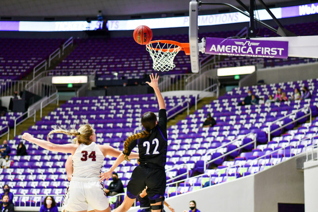 Weber State's gaurd, Aloma Solovi giving WSU the lead with a lay-up.  Lady Wildcats hosts the Feb. 13 game against Montana's Griz.  Nikki Dorber / The Signpost