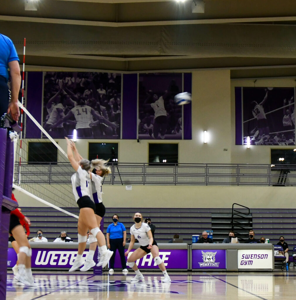 Defending the win at the net, Wildcats work as a team to claim a victory at the end of the second game against Southern Utah University. (Nikki Dorber / The Signpost)
