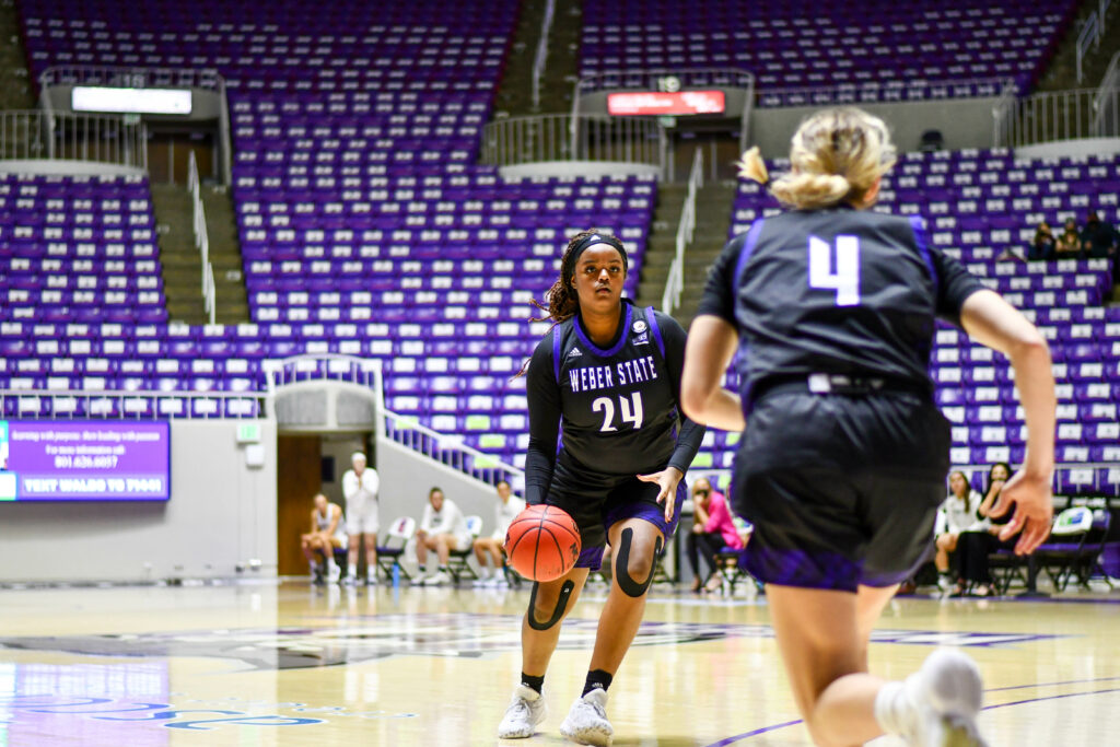 Weber State's Dominique Williams setting up to shoot one of many three point baskets in Saturday's game against Montana's Griz.  (Nikki Dorber / The Signpost)