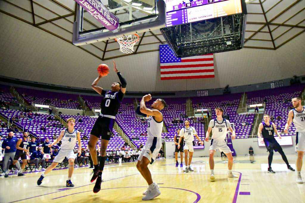 Weber State's Zahir Porter with a layup, gaining 2 points in Saturday's game against Northern Arizona.  (Nikki Dorber / The Signpost)