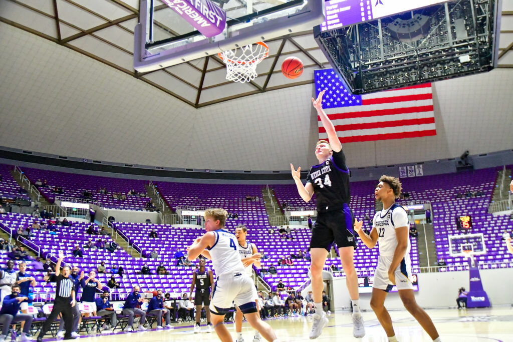 Weber State's Cody Carlson shoots in a two point basket in Saturday's game against Northern Arizona.  (Nikki Dorber / The Signpost)