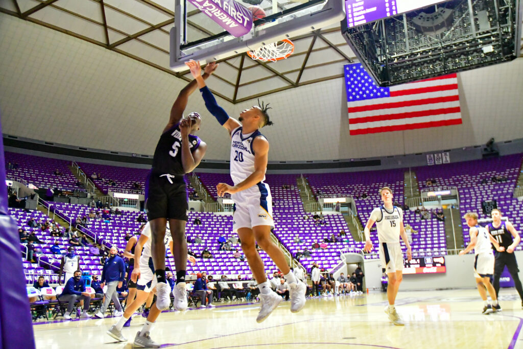 Weber State's Sisoho Jawara with a 2 point bucket in Saturday's game against Northern Arizona.  (Nikki Dorber / The Signpost)
