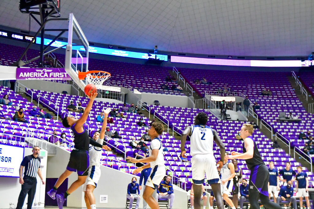 Weber State's Zahir Porter with a layup, gains 2 points in Saturday's game against Northern Arizona.  (Nikki Dorber / The Signpost)