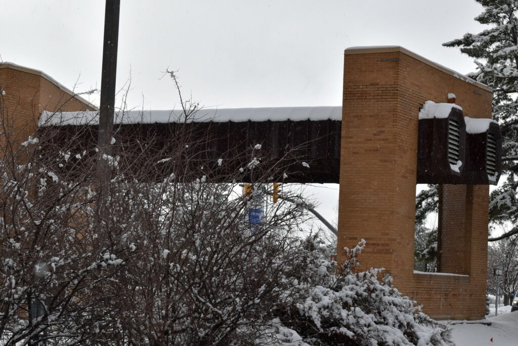 Snow covers the Dee Events Center Marquee at Weber State University before demolition begins in March. (Paige McKinnon/The Signpost)