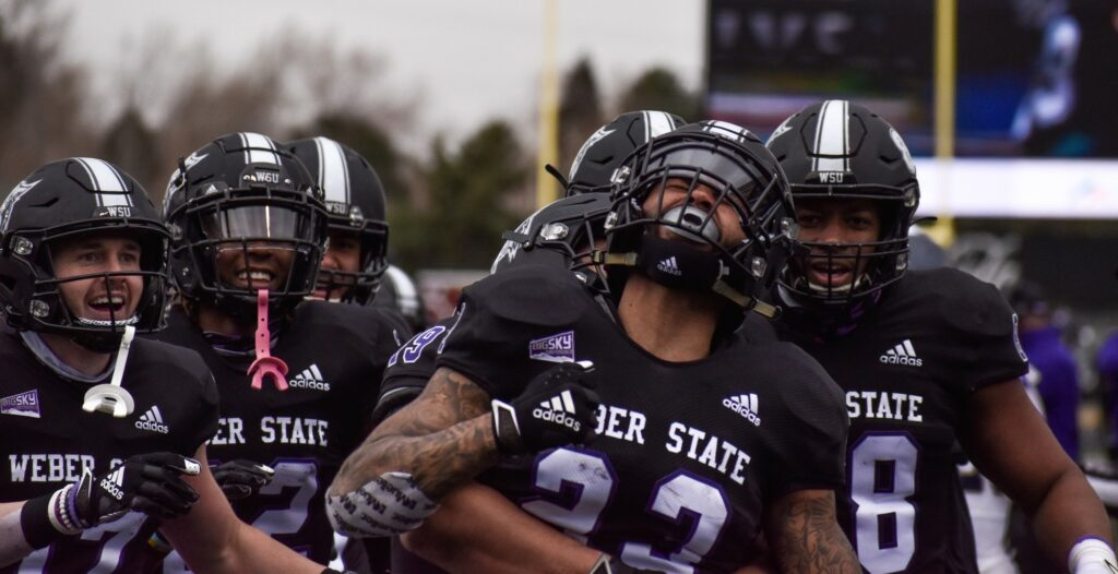 The Weber State wildcats celebrate their touchdown that led them to a win on their home field. (Paige McKinnon/The Signpost)