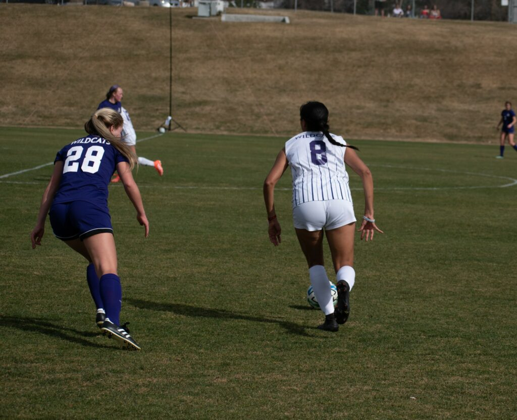 Jersey number eight take the ball down the field at Weber State University on March 19. (Paige McKinnon/The Signpost)