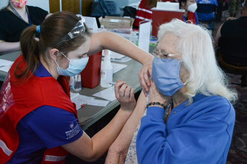Weber State University Nursing Student, Necia Wallenmeyer administers a COVID-19 vaccination to Lorna Ricks, Tuesday Mar. 16, 2021, in Ogden, Utah. (Brooklynn Kilgore/The Signpost)