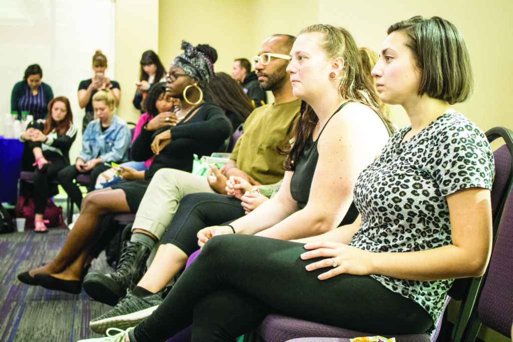 Attendees of the Sister Circle listen as other attendees introduce themselves. (Kalie Pead/ The Signpost)