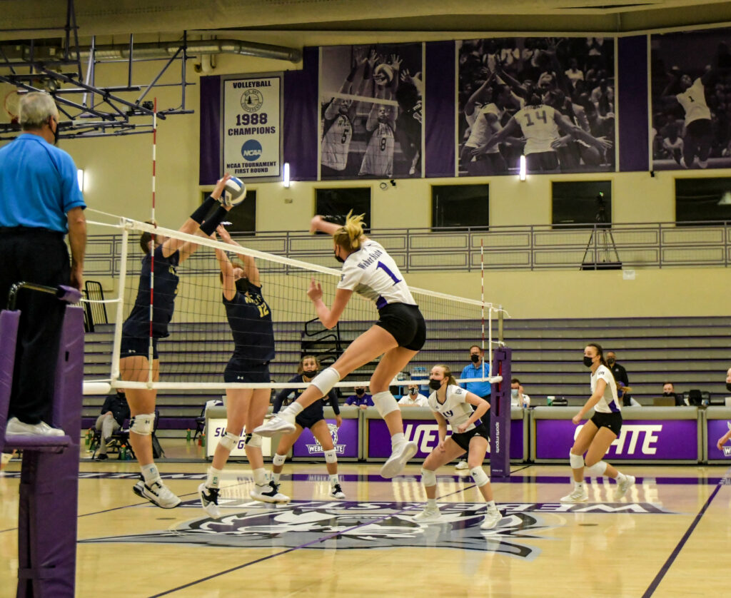 Weber State outside hitter (1) Rylin Adams spikes the ball against Montana State on Saturday, March 20, 2021 at Swenson Gym in Ogden. WSU wins the game, making them the Big Sky champions for the first time in Weber State history. Nikki Dorber/The Signpost