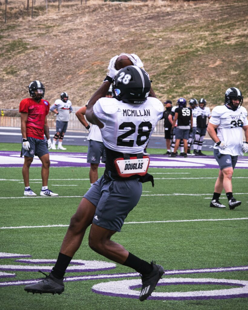 Wildcat running back Dontae McMillan catches a pass out of the backfield in practice at Stewart Stadium.