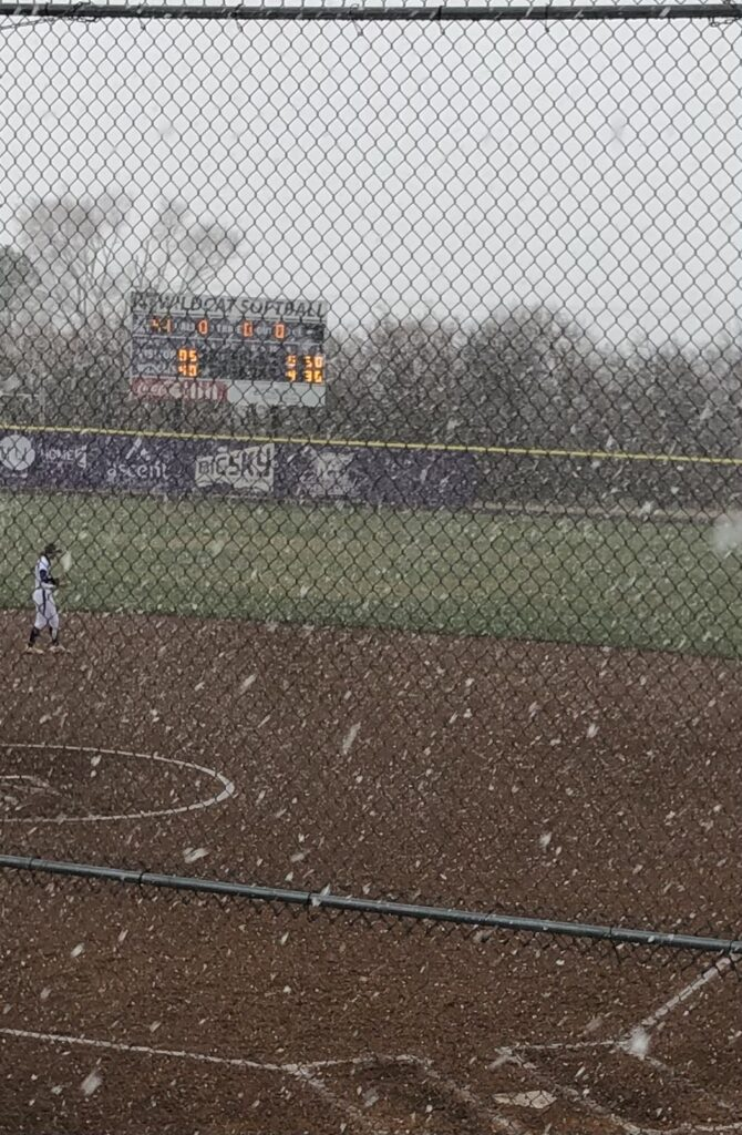 The Wildcat Softball Field scoreboard's illuminated minutes before the game against Utah State was canceled in Ogden on March 23.