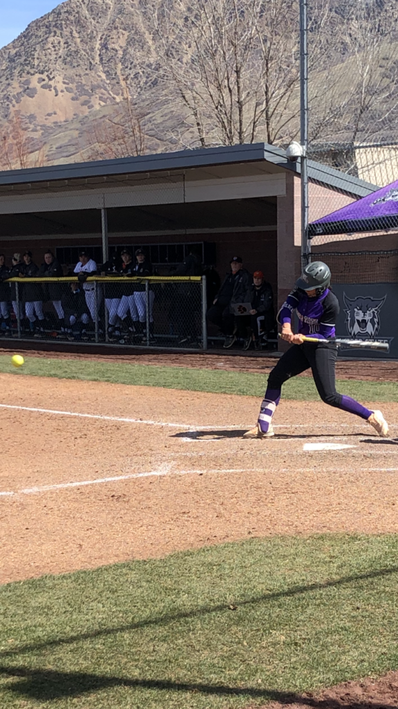 Wildcat second baseman Faith Hoe swings at a Bengal pitch at Wildcat Softball Field in Ogden on March 28.