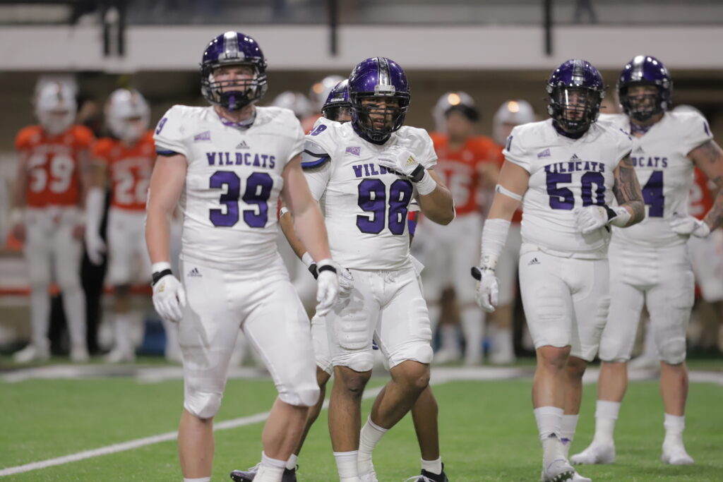 The Wildcats scored seven touchdowns, four by air and three by land, on the way to a 49–21 blowout victory.