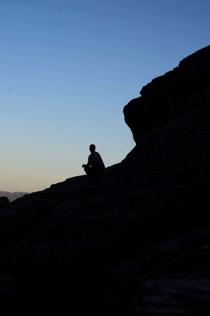 A man finds a spot on the rocks to watch the sunset. Nikki Dorber/The Signpost