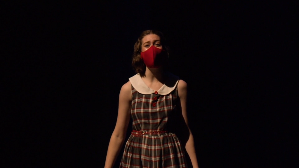 """Abigail Philpott performs """"First You Dream"""" solo at the Weber State University Theatre musical """"Crushing the Curve: Behind the Curtain"""" while wearing a mask due to COVID-19 safety restrictions. (Abdulrahman Almohammadi / The Signpost)"""