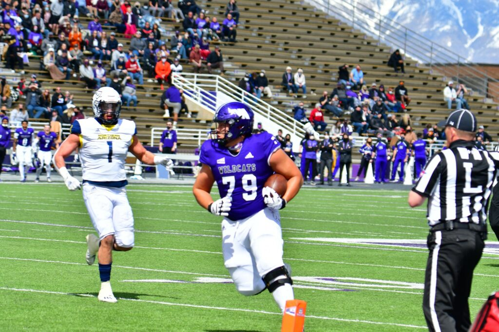 Wildcat O-lineman Noah Atagi running into the end zone for WSU's second touchdown vs. Northern Arizona on March 27 at Stewart Stadium.