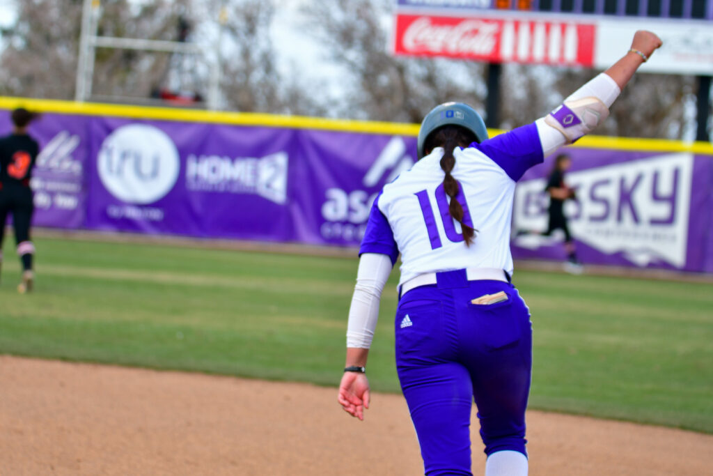 Faith Hoe, of Weber State University softball team hits the first of two home runs in Saturday's game against Idaho State. (Nikki Dorber/The Signpost)