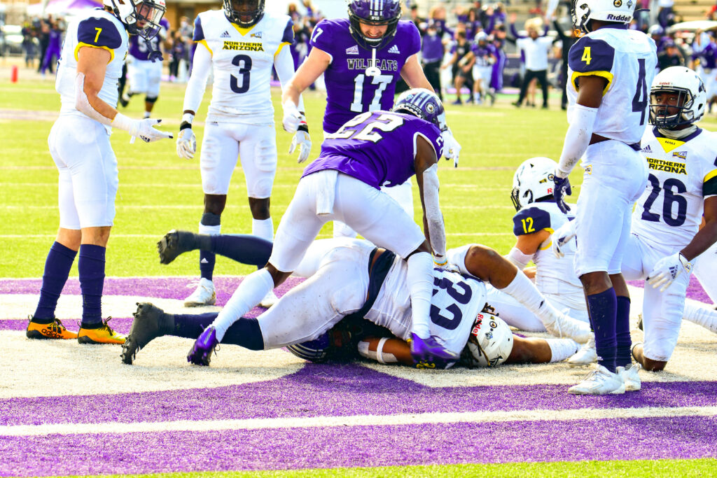 Weber State University's Rasheed Shaheed, 22, ensuring Justin Malone, 88, caught the ball during a Hail Mary that gave WSU their win during the game on Saturday March 27 against Northern Arizona University. Nikki Dorber/The Signpost