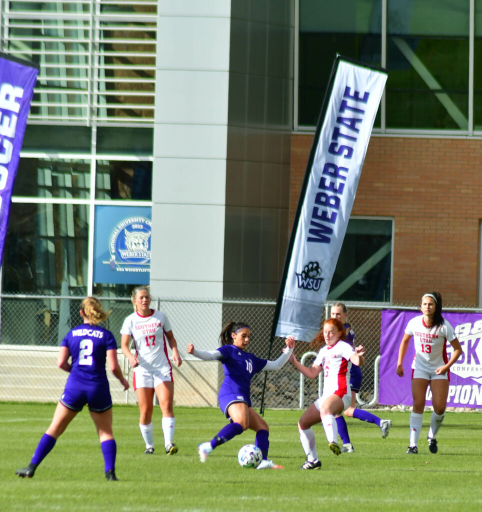 Midfielder, Jasmine Lotey, keeps the ball from Southern Utah on Saturday March 26 at Weber State's soccer field. Nikki Dorber/The Signpost