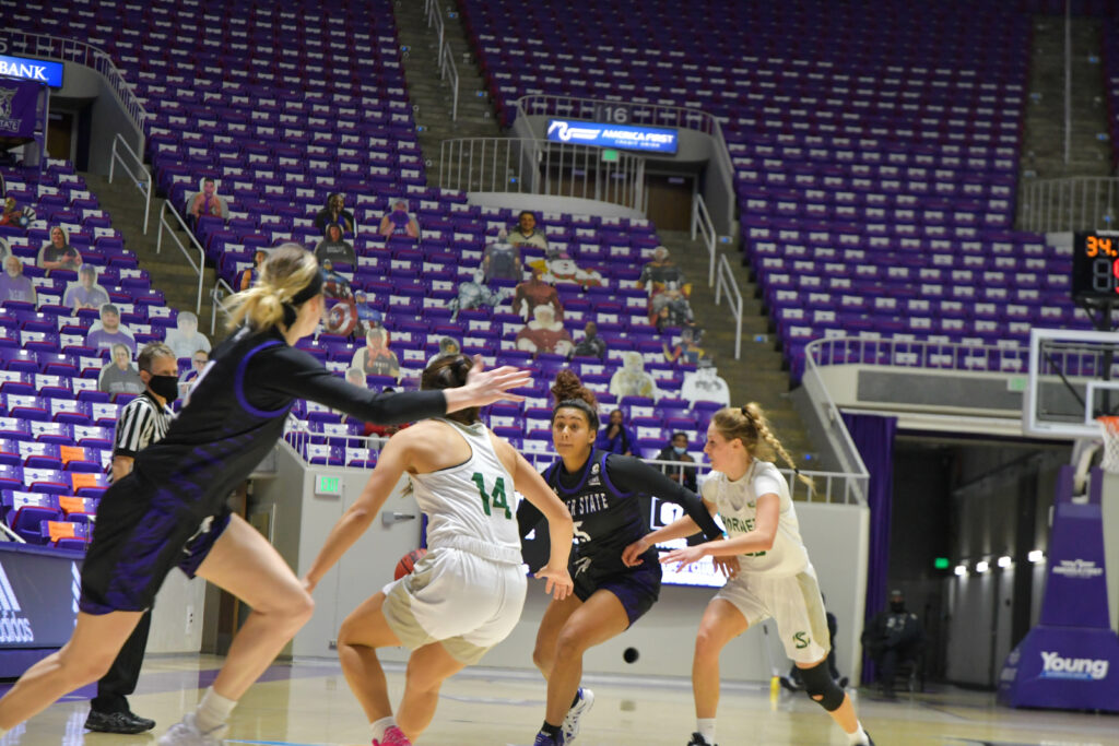 Daryn Hickok makes her way down the court, fighting off Sacramento Hornets in Saturday's game which resulted in an overtime win of 75-69. The game is the final home game for the Lady Wildcats for this season. (Nikki Dorber/The Signpost)