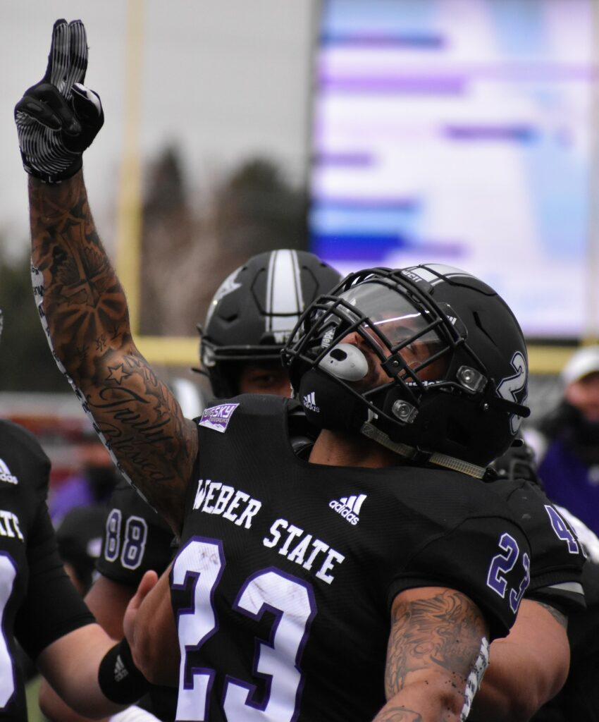 Player 23, Wright Jr., celebrating his touchdown on Saturday at Weber State University. (Paige McKinnon/The Signpost)