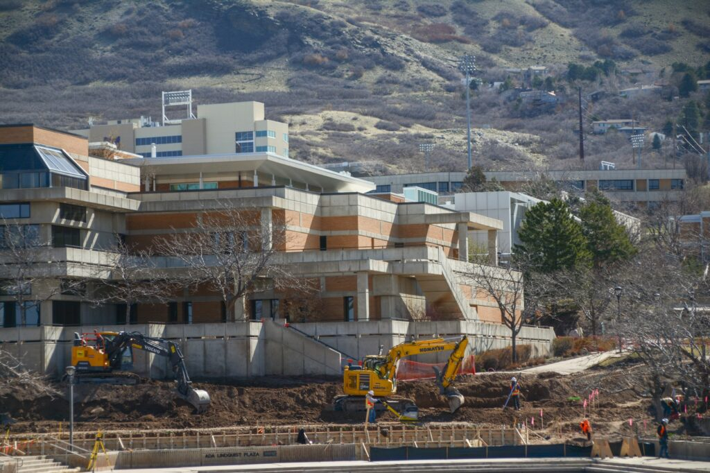 View of the new construction from accross the duck pond, Wednesday, Mar. 31, 2021. Two excavators carve out the future bus route. (Brooklynn Kilgore/The Signpost)