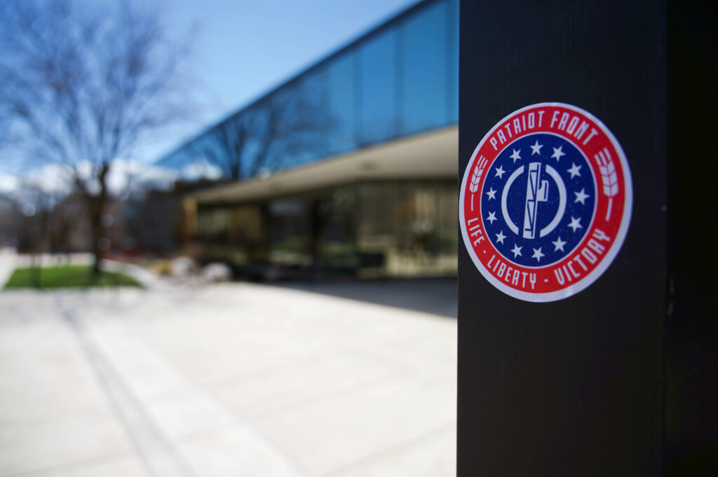 Several sticks from the white supremacist group Patriot Front are posted around campus. (Joshua Wineholt / The Signpost)