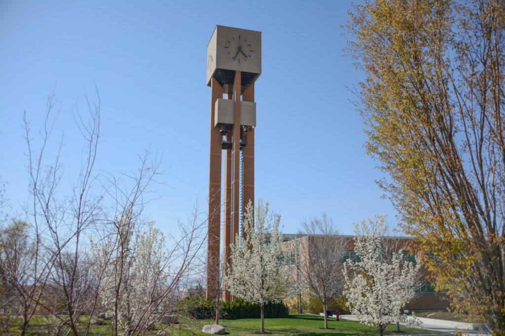 Weber State Bell tower stands tall in the spring blossoms, Monday, Apr. 12, 2021 on Weber State University Campus. (Brooklynn Kilgore/The Signpost)
