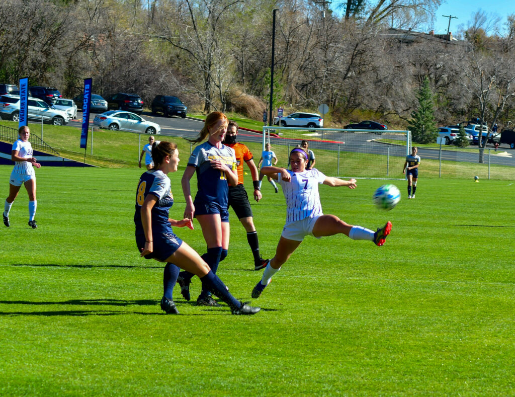 Mylee Broad, 7,  jumps to keep control of the ball, despite Northern Colorado's coverage. (Nikki Dorber/The Signpost)