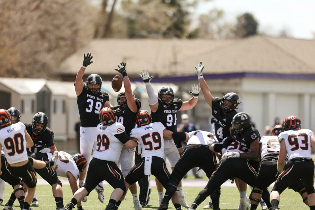 Weber State tries to stop Idaho State from making a field goal, securing their win of 20-15, on April 10, 2021. (Robert Casey / Weber State Athletics)